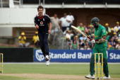 James Anderson of England celebrates the wicket of Hashim Amla during the 4th One Day International match between South Africa and England at St...