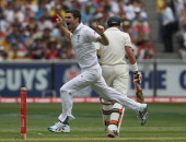 James Anderson of England celebrates the wicket of Michael Hussey of Australia during day one of the Fourth Test match between Australia and England...