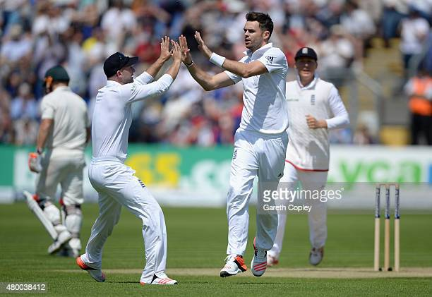 James Anderson of England celebrates with Adam Lyth after dismissing David Warner of Australia during day two of the 1st Investec Ashes Test match...
