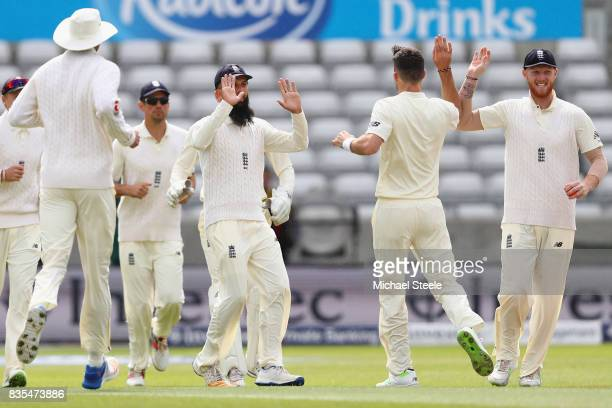 James Anderson of England celebrates with Ben Stokes after taking the wicket of Kyle Hope during day three of the 1st Investec Test match between...