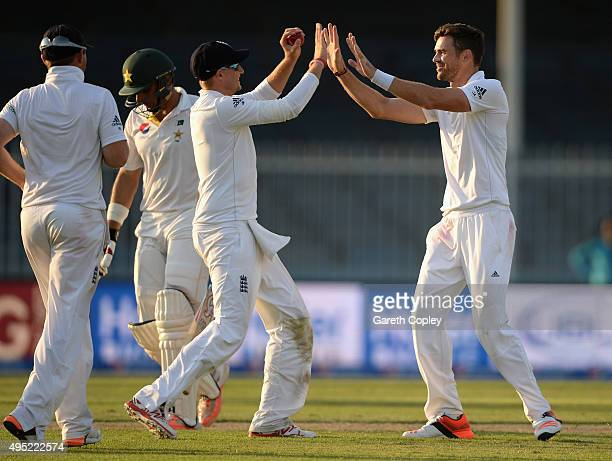 James Anderson of England celebrates with Joe Root after dismissing Pakistan captain MisbahulHaq during day one of the 3rd Test between Pakistan and...