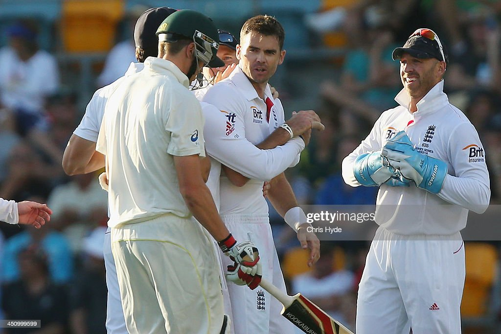 James Anderson of England celebrates with team mates after dismissing Peter Siddle of Australia during day one of the First Ashes Test match between Australia and England at The Gabba on November 21, 2013 in Brisbane, Australia.