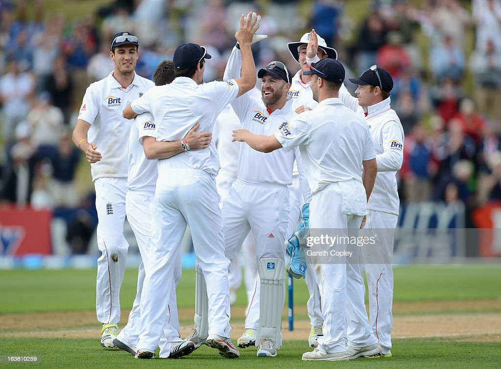 James Anderson of England celebrates with teammates after dismissing Peter Fulton of New Zealand during day four of the second Test match between New Zealand and England at Basin Reserve on March 17, 2013 in Wellington, New Zealand.