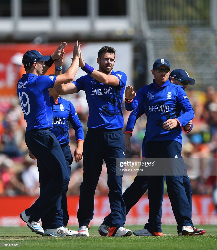 James Anderson of England celebrates with teammates after taking the wicket of Calum MacLeod of Scotland during the 2015 ICC Cricket World Cup match...