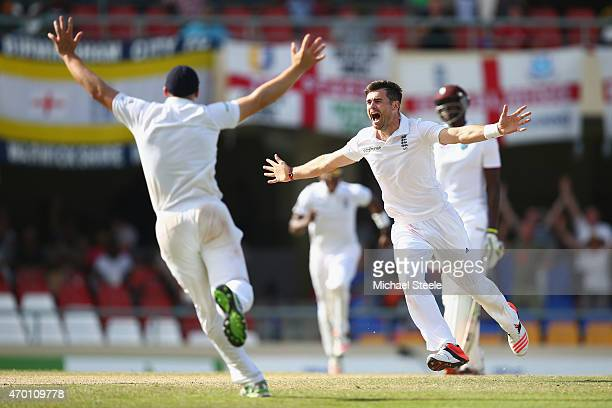 James Anderson of England claims the wicket of Denesh Ramdin of West Indies to pass Ian Botham's record of 383 Test wickets and become England's...