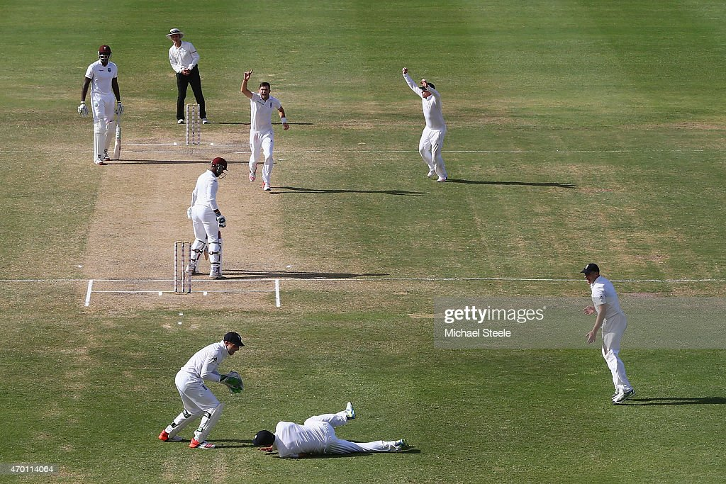 <a gi-track='captionPersonalityLinkClicked' href=/galleries/search?phrase=James+Anderson+-+Cricket&family=editorial&specificpeople=6920305 ng-click='$event.stopPropagation()'>James Anderson</a> of England claims the wicket of <a gi-track='captionPersonalityLinkClicked' href=/galleries/search?phrase=Denesh+Ramdin&family=editorial&specificpeople=542842 ng-click='$event.stopPropagation()'>Denesh Ramdin</a> of West Indies caught by <a gi-track='captionPersonalityLinkClicked' href=/galleries/search?phrase=Alastair+Cook+-+Joueur+de+cricket&family=editorial&specificpeople=571475 ng-click='$event.stopPropagation()'>Alastair Cook</a> at first slip to pass Ian Botham's record of 383 Test wickets and become England's highest Test wicket bowler during day five of the 1st Test match between West Indies and England at the Sir Vivian Richards Stadium on April 17, 2015 in Antigua, Antigua and Barbuda.