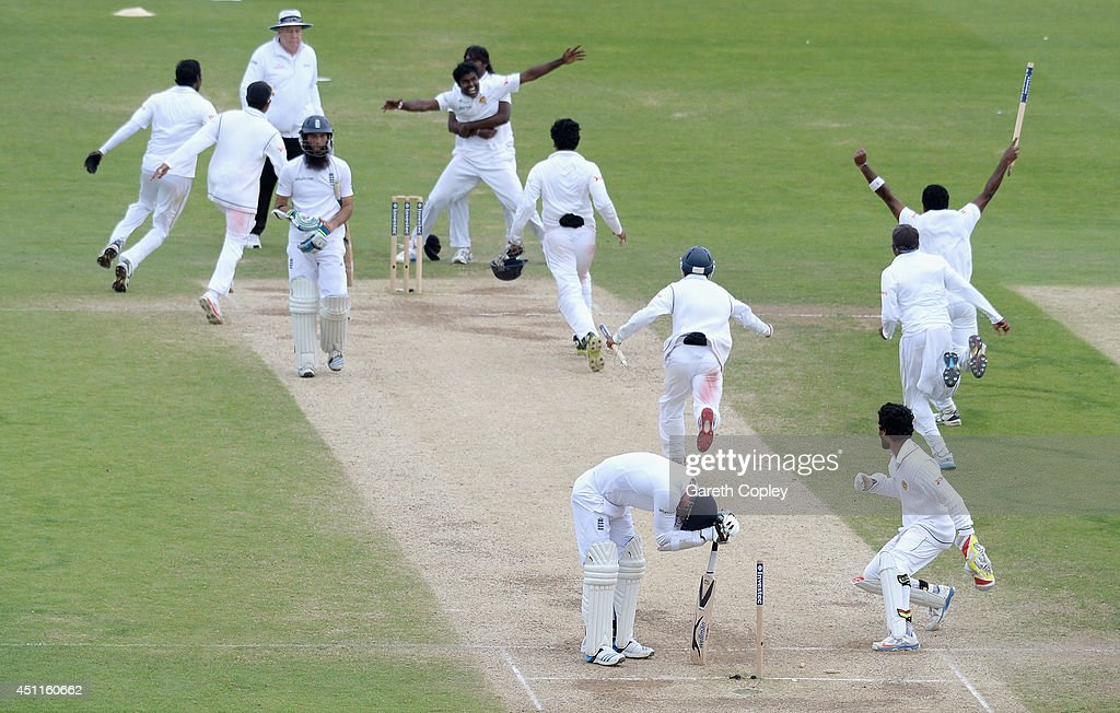 James Anderson of England hangs his head over his bat as Sri Lanka winning the 2nd Investec Test match between England and Sri Lanka at Headingley Cricket Ground on June 24, 2014 in Leeds, England.