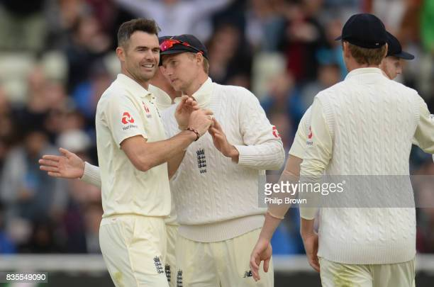 James Anderson of England is congratulated after dismissing Kieran Powell of the West Indies during the third day of the 1st Investec Test match...