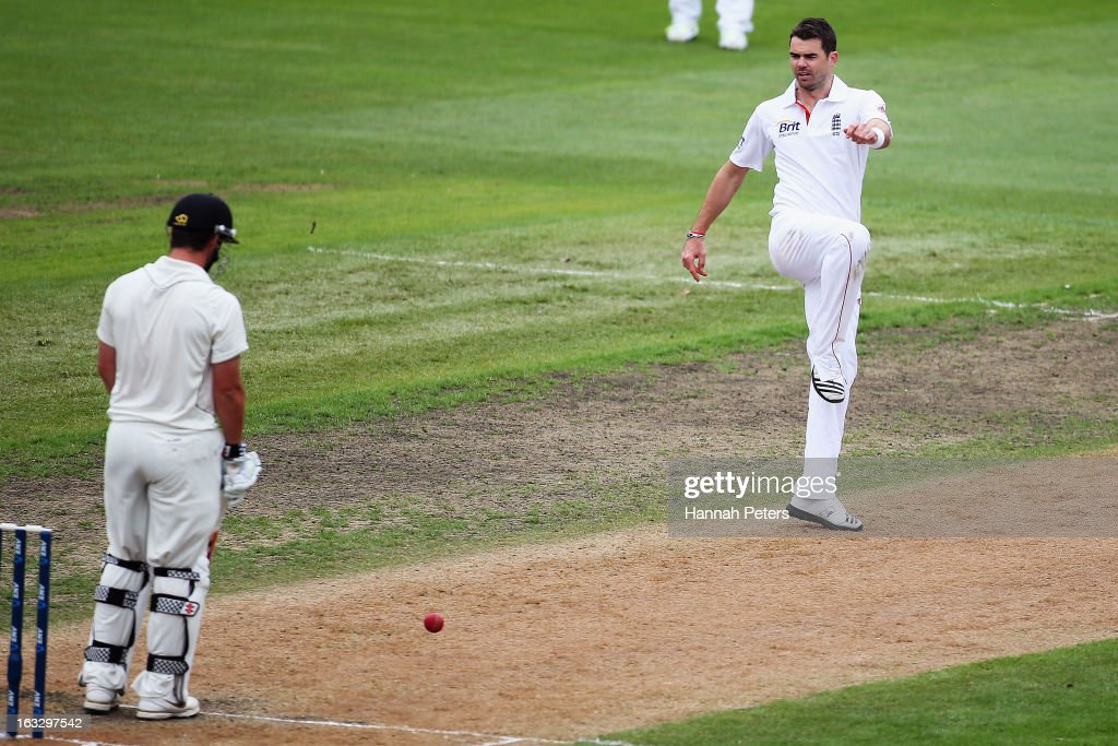 James Anderson of England kicks the ball back in frustration during day three of the First Test match between New Zealand and England at University Oval on March 8, 2013 in Dunedin, New Zealand.