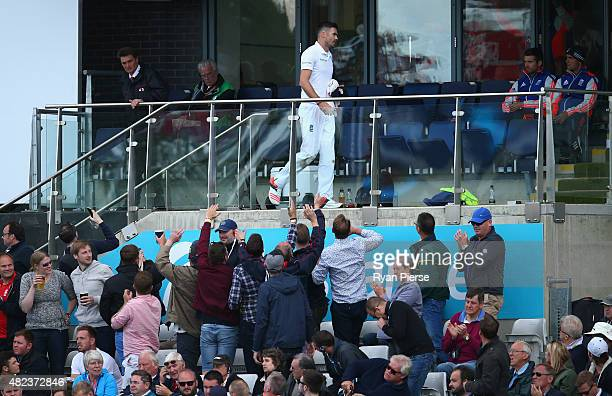 James Anderson of England leaves the ground after suffering an injury while bowling during day two of the 3rd Investec Ashes Test match between...