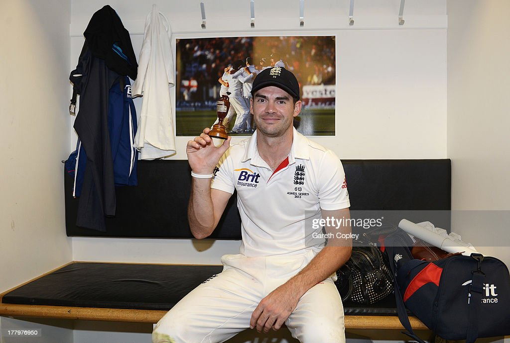 James Anderson of England poses with the urn in the dressing room after winning the Ashes during day five of the 5th Investec Ashes Test match between England and Australia at the Kia Oval on August 25, 2013 in London, England.