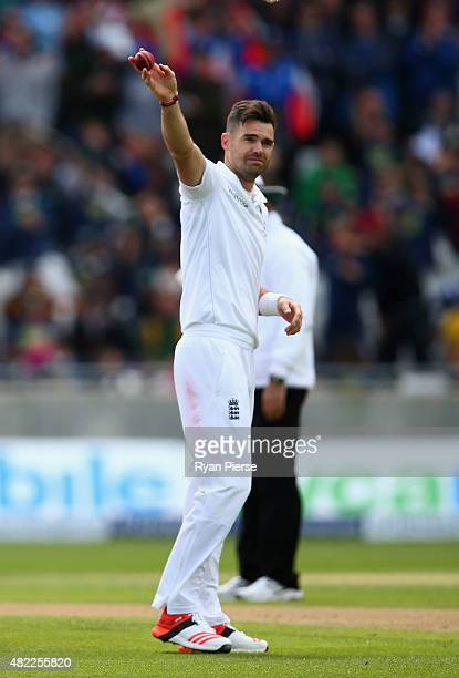 James Anderson of England raises the ball after claiming his fifth wicket during day one of the 3rd Investec Ashes Test match between England and...
