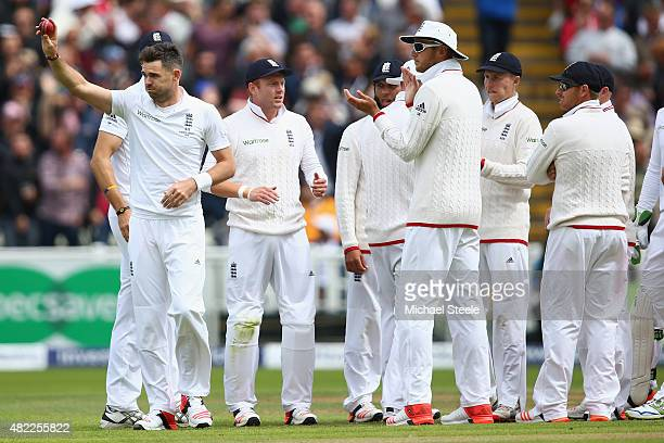 James Anderson of England raises the match ball after claiming the wicket of Mitchell Johnson his fifth wicket of the innings during day one of the...