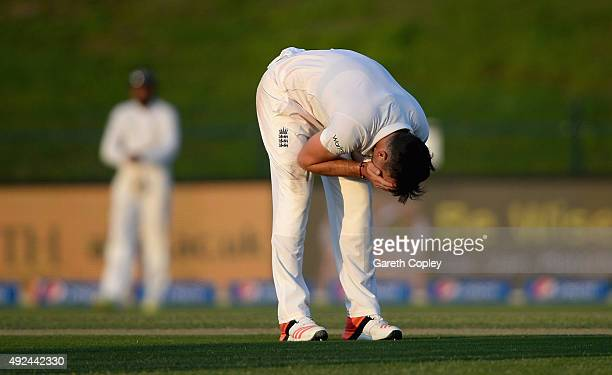 James Anderson of England reacts after Ian Bell drops Shoaib Malik of Pakistan during the 1st Test between Pakistan and England at Zayed Cricket...