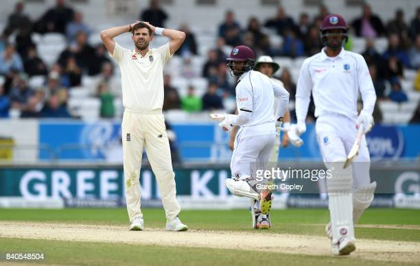 James Anderson of England reacts as Shai Hope and Roston Chase of the West Indies score runs during day five of the 2nd Investec Test between England...