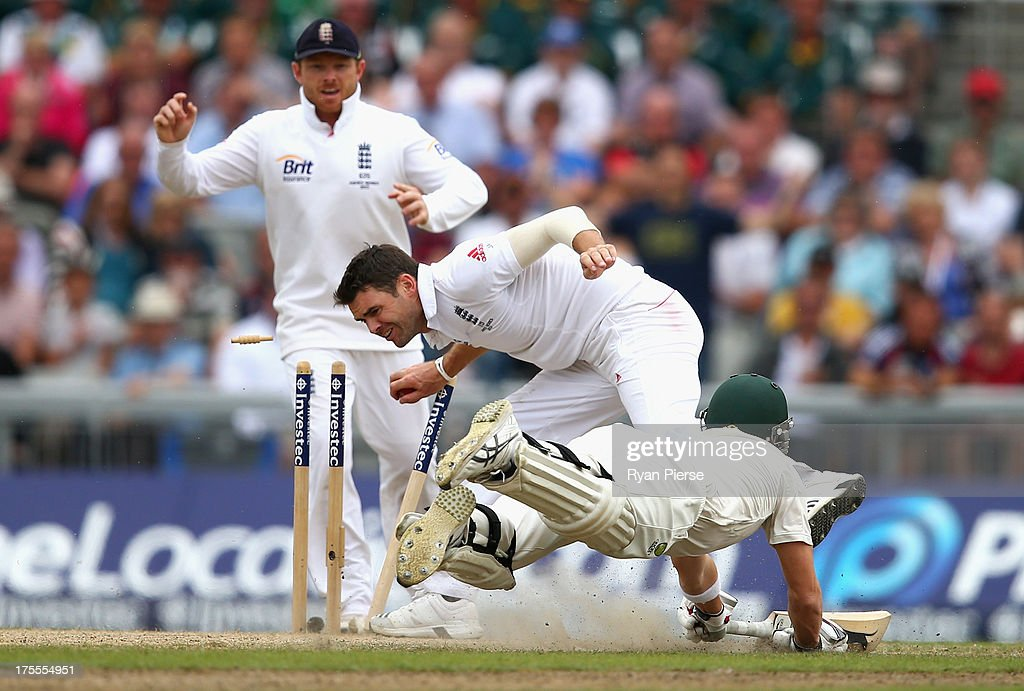 James Anderson of England runs out Steve Smith of Australia during day four of the 3rd Investec Ashes Test match between England and Australia at Emirates Old Trafford Cricket Ground on August 4, 2013 in Manchester, England.