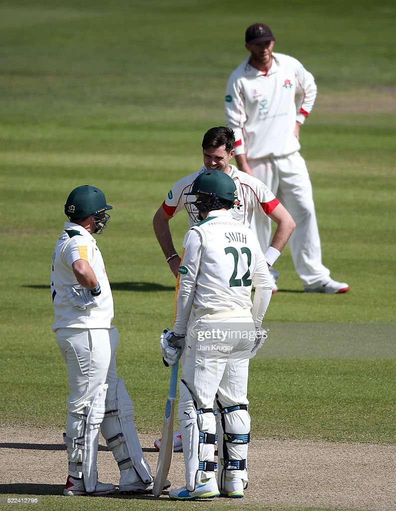 James Anderson of Lancashire has words with Steven Mullaney and Greg Smith of Nottinghamshire during day three of the Specsavers County Championship...