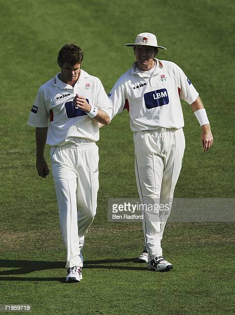 James Anderson of Lancashire receives encouragement from team mate Dominic Cork during the Liverpool Victoria County Championship match between...