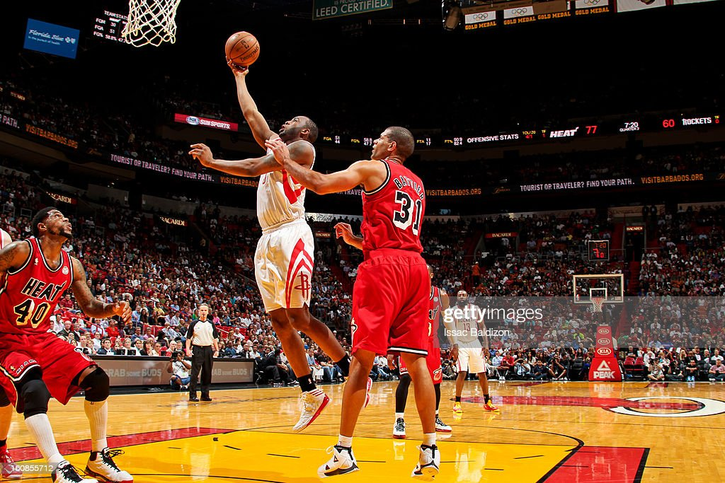 James Anderson #5 of the Houston Rockets drives to the basket against Shane Battier #31 of the Miami Heat on February 6, 2013 at American Airlines Arena in Miami, Florida.