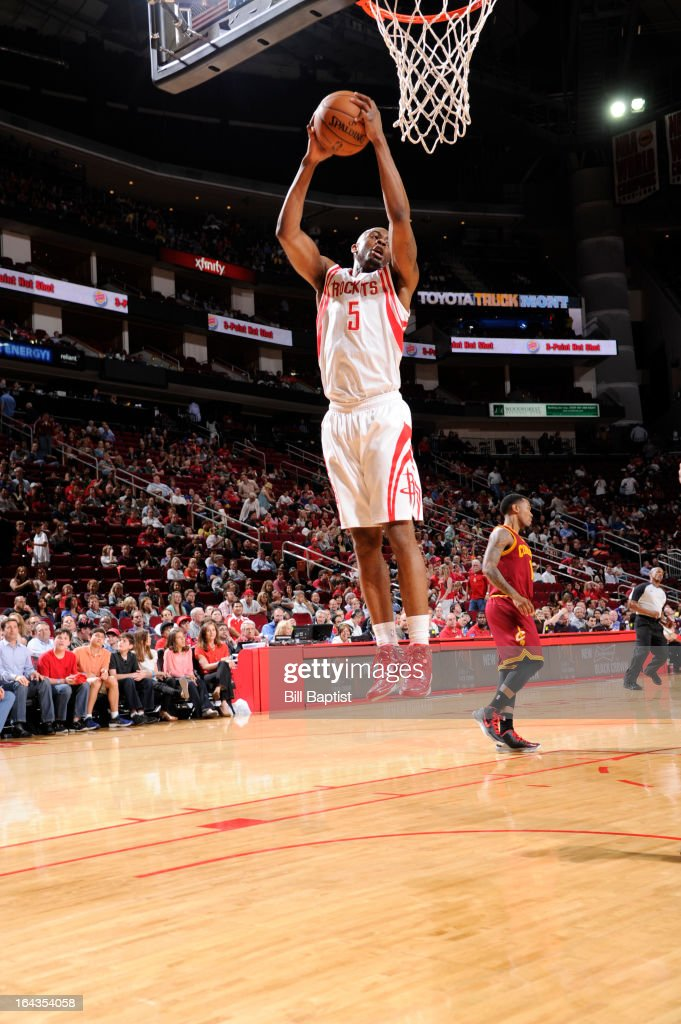 James Anderson #5 of the Houston Rockets rebounds the ball against the Cleveland Cavaliers on March 22, 2013 at the Toyota Center in Houston, Texas.