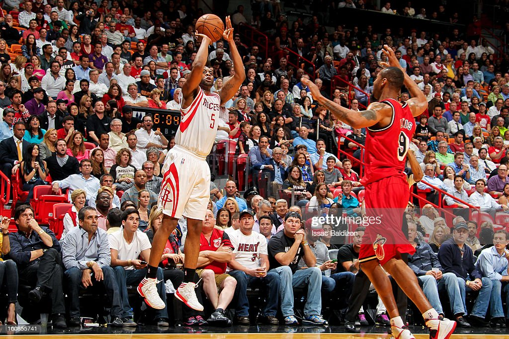 James Anderson #5 of the Houston Rockets shoots a three-pointer against <a gi-track='captionPersonalityLinkClicked' href=/galleries/search?phrase=Rashard+Lewis&family=editorial&specificpeople=201713 ng-click='$event.stopPropagation()'>Rashard Lewis</a> #9 of the Miami Heat on February 6, 2013 at American Airlines Arena in Miami, Florida.