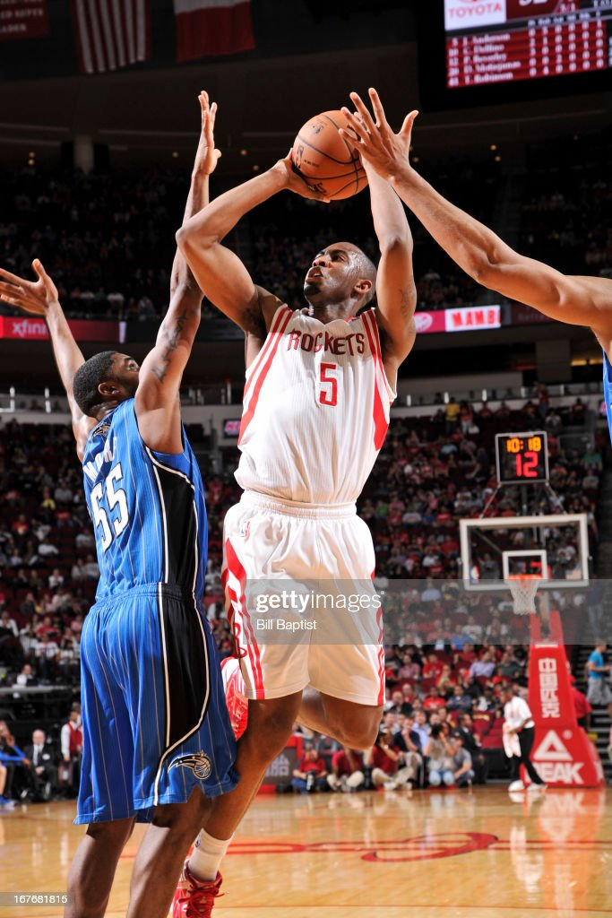 James Anderson #5 of the Houston Rockets shoots against <a gi-track='captionPersonalityLinkClicked' href=/galleries/search?phrase=E%27Twaun+Moore&family=editorial&specificpeople=4877476 ng-click='$event.stopPropagation()'>E'Twaun Moore</a> #55 of the Orlando Magic on April 1, 2013 at the Toyota Center in Houston, Texas.