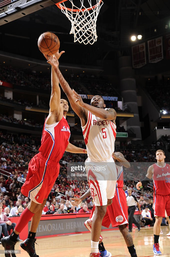 James Anderson #5 of the Houston Rockets shoots against <a gi-track='captionPersonalityLinkClicked' href=/galleries/search?phrase=Ryan+Hollins&family=editorial&specificpeople=182556 ng-click='$event.stopPropagation()'>Ryan Hollins</a> #15 of the Los Angeles Clippers on March 30, 2013 at the Toyota Center in Houston, Texas.