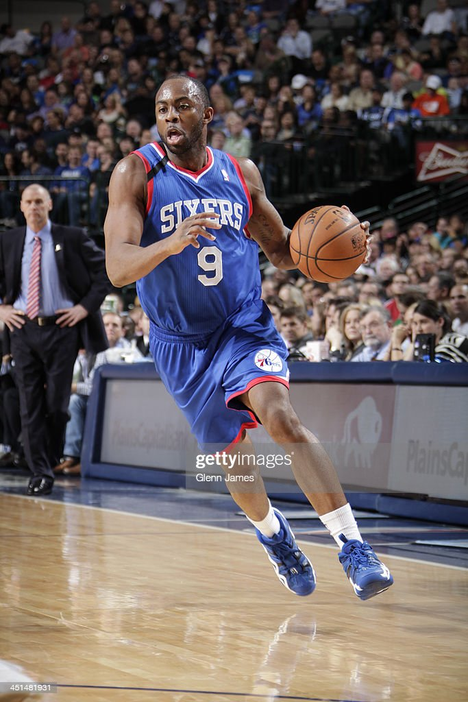 James Anderson #9 of the Philadelphia 76ers dribbles the ball against the Dallas Mavericks on November 18, 2013 at the American Airlines Center in Dallas, Texas.