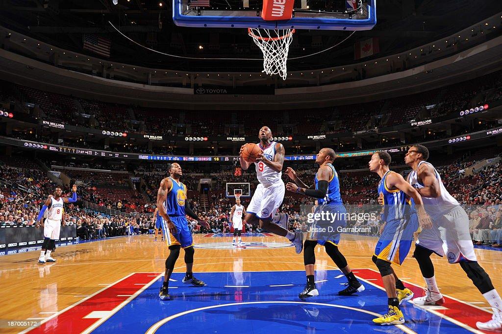 James Anderson #9 of the Philadelphia 76ers drives to the basket against the Golden State Warriors at the Wells Fargo Center on November 4, 2013 in Philadelphia, Pennsylvania.