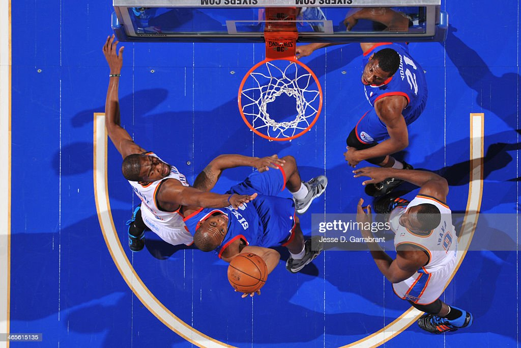 James Anderson #9 of the Philadelphia 76ers drives to the basket against the Oklahoma City Thunder at the Wells Fargo Center on January 25, 2014 in Philadelphia, Pennsylvania.