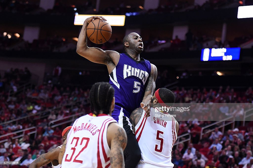 James Anderson #5 of the Sacramento Kings draws a foul from Josh Smith #5 of the Houston Rockets during the second half of a game at the Toyota Center on April 13, 2016 in Houston, Texas. The Rockets defeated the Kings 116-81.