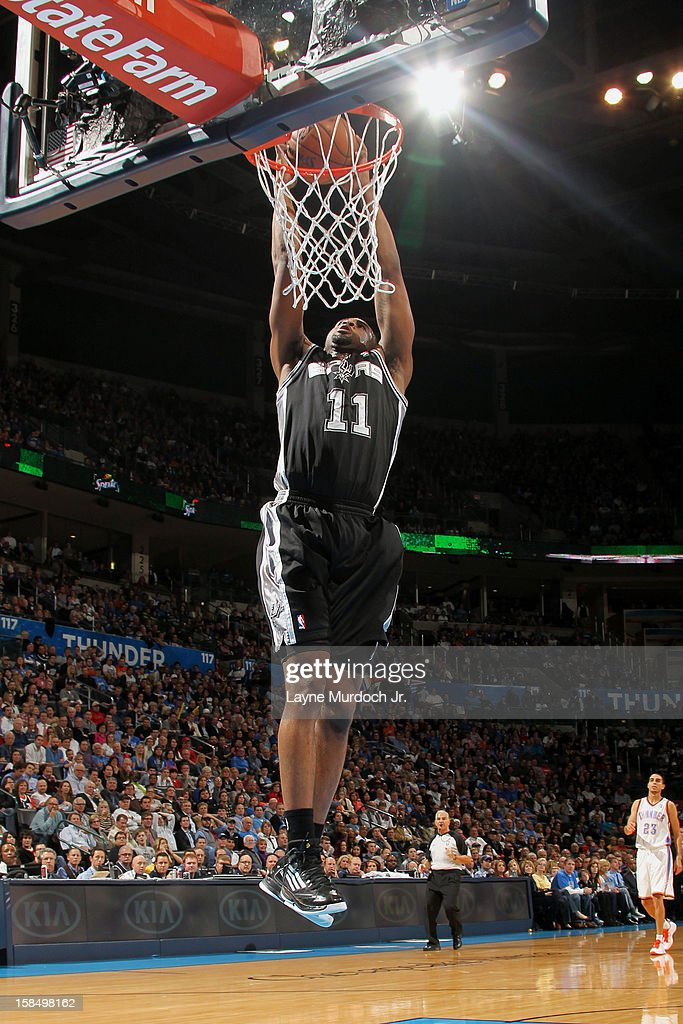James Anderson #11 of the San Antonio Spurs goes in for the dunk against the Oklahoma City Thunder during an NBA game on December 17, 2012 at the Chesapeake Energy Arena in Oklahoma City, Oklahoma.