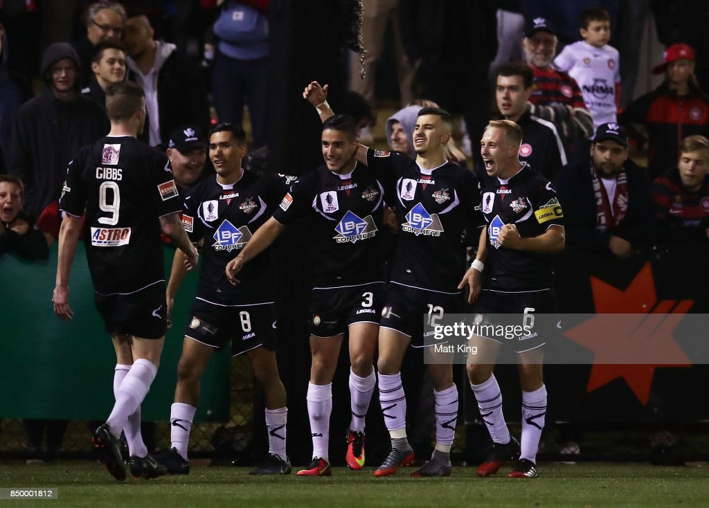 James Andrew of Blacktown City celebrates with team mates after scoring a goal in extra time during the FFA Cup Quarterfinal match between Blacktown City and the Western Sydney Wanderers at Lily Football Centre on September 20, 2017 in Sydney, Australia.