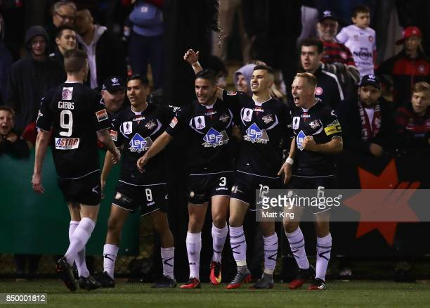 James Andrew of Blacktown City celebrates with team mates after scoring a goal in extra time during the FFA Cup Quarterfinal match between Blacktown...