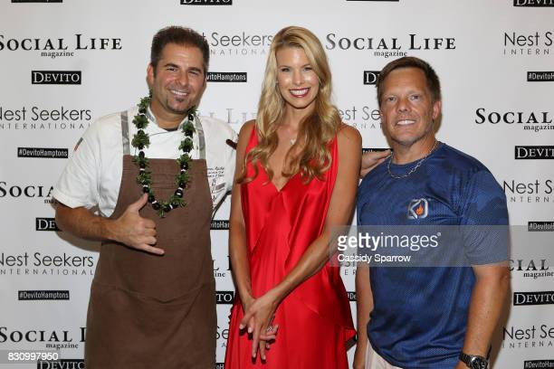 James Aptakin Beth Stern and Michael Gotowala attend the Social Life Magazine Nest Seekers August Issue Party on August 12 2017 in Southampton New...