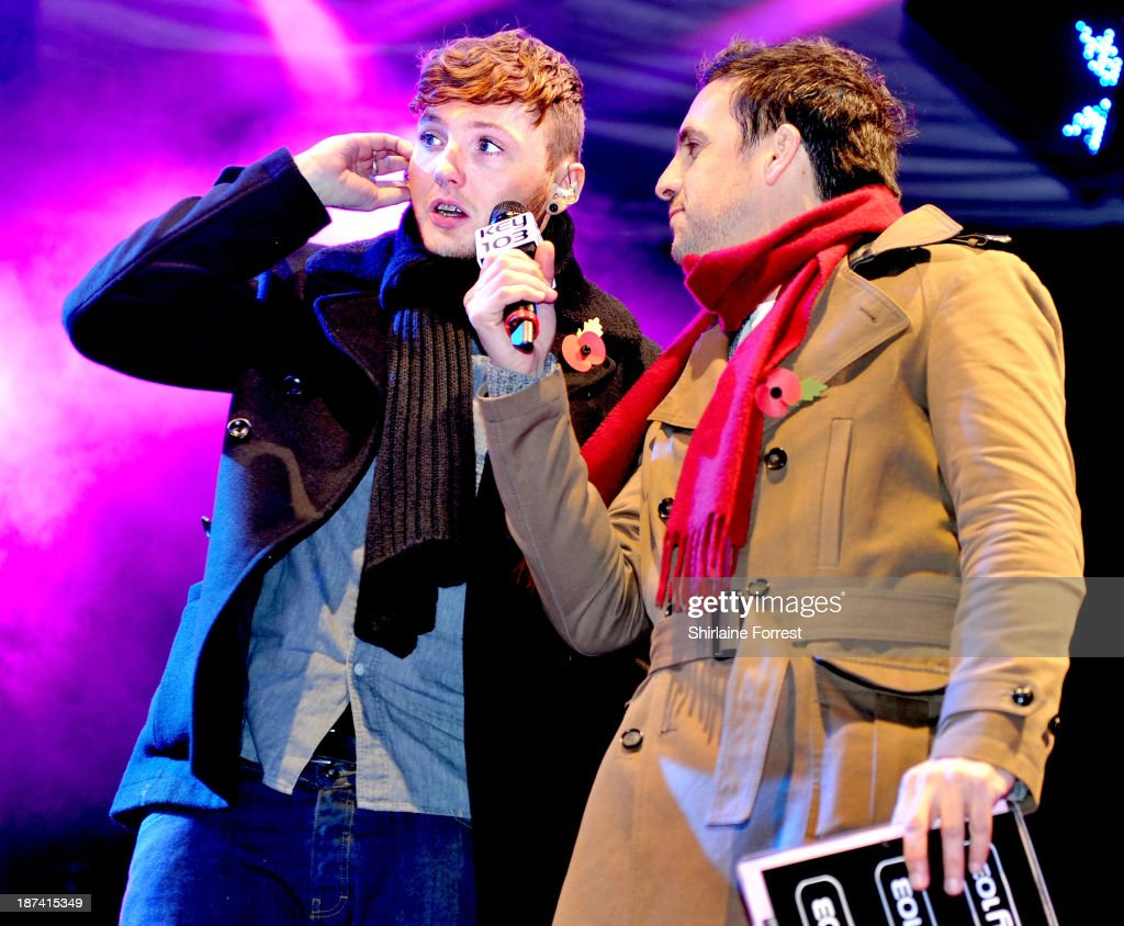 James Arthur and Mike Toolan onstage at the switch on of the Manchester Christmas lights at Albert Square on November 8, 2013 in Manchester, England.