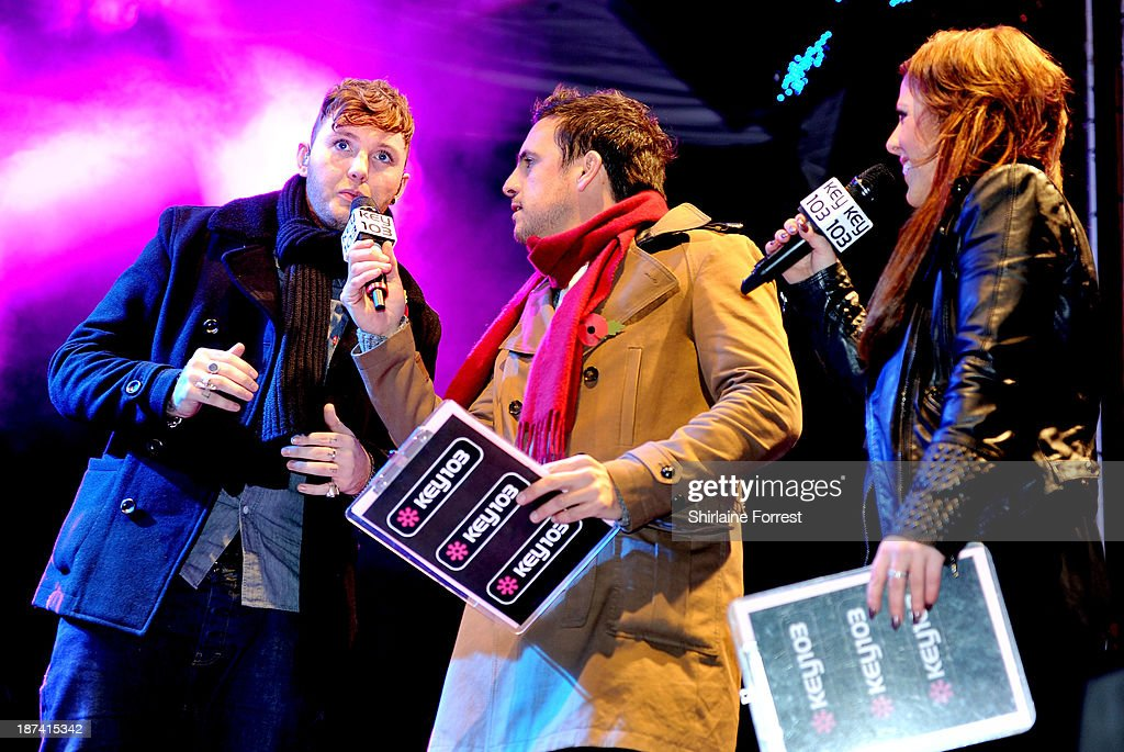 James Arthur, Chelsea Norris and Mike Toolan onstage at the switch on of the Manchester Christmas lights at Albert Square on November 8, 2013 in Manchester, England.