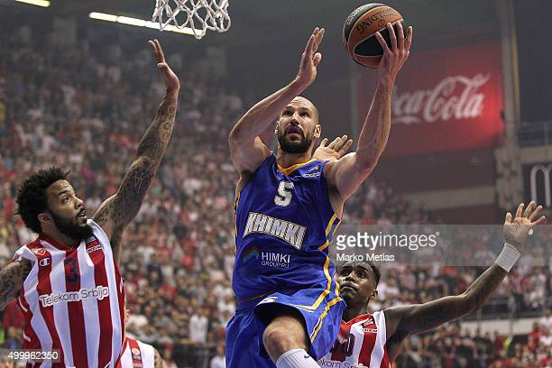 James Augustine #5 of Khimki Moscow Region competes with Marcus Williams #3 of Crvena Zvezda Telekom Belgrade during the Turkish Airlines Euroleague...