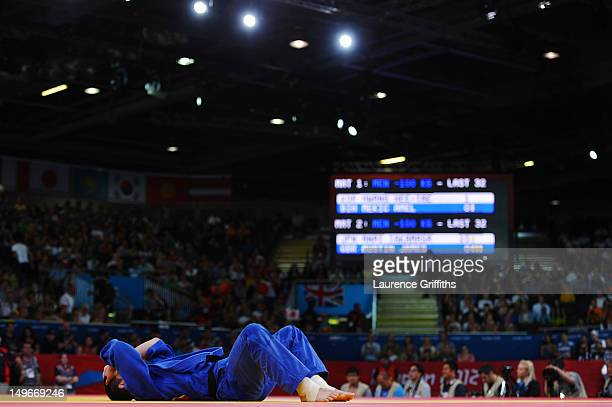 James Austin of Great Britain lays on the mat during his match against Takahiro Nakai of Japan in the Men's 100 kg Judo on Day 6 of the London 2012...