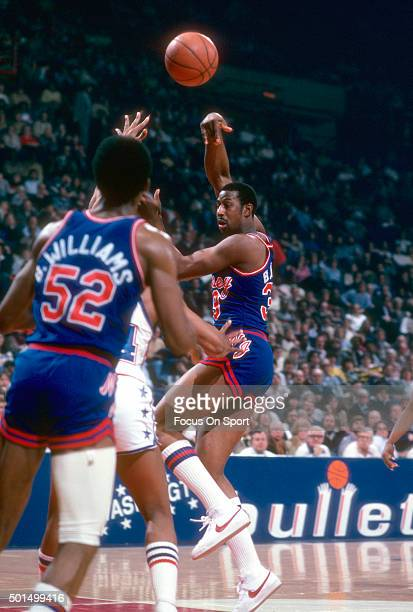 James Bailey of the New Jersey Nets passes the ball to Buck Williams against the Washington Bullets during an NBA basketball game circa 1981 at the...