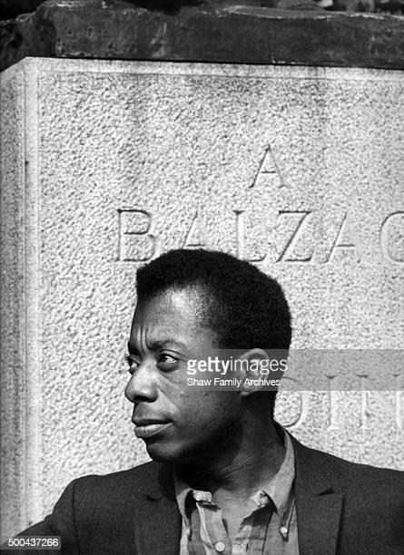 James Baldwin below Auguste Rodin's statue of Honore de Balzac in 1960 in Paris France