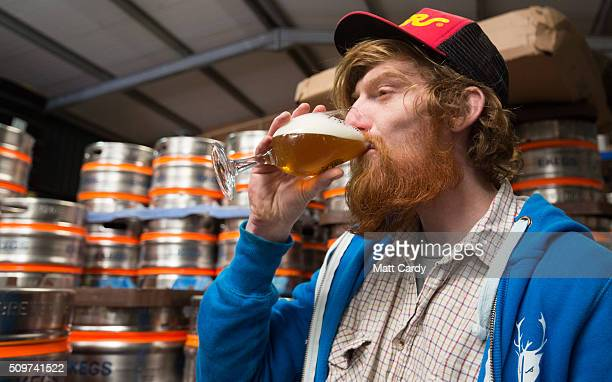 James Bardgett checks the quality of beer before filling up kegs and barrels to be dispatched at the Wild Beer Co brewery at Lower Westcombe Farm on...