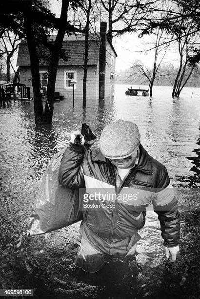 James Baril needed to go back for additional clothing after he and his wife evacuated their home on the bank of the Merrimack River in Methuen Mass...
