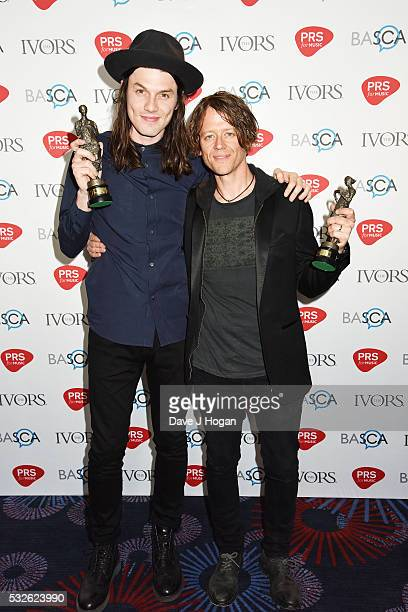 James Bay and Iain Archer pose for a photo after winning the award for Most Performed Work in the winners room during the Ivor Novello Awards at...