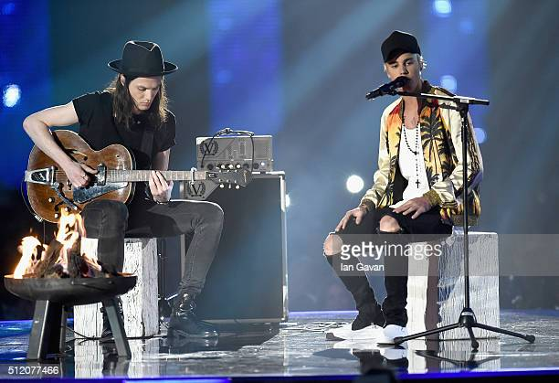 James Bay and Justin Bieber perform on stage at the BRIT Awards 2016 at The O2 Arena on February 24 2016 in London England