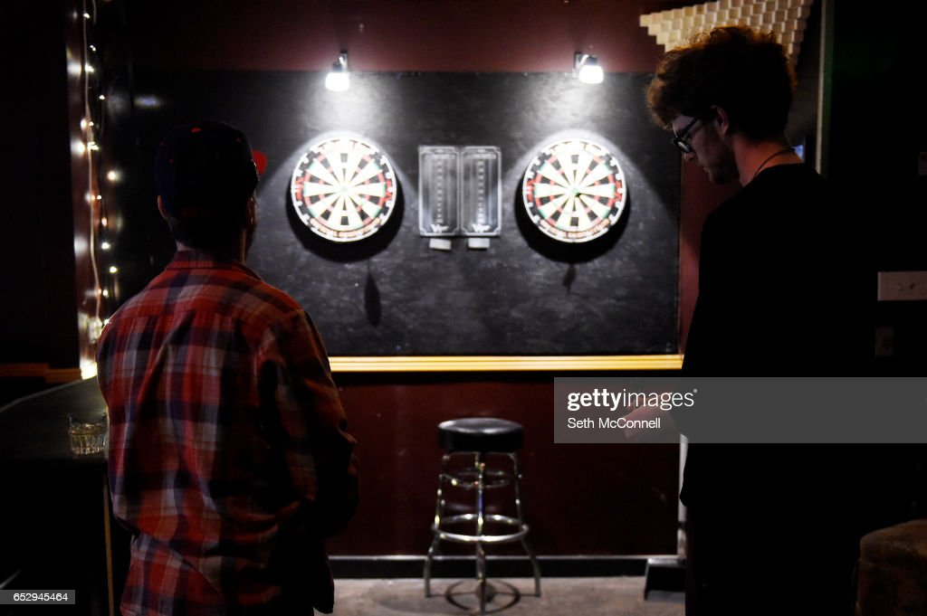 James Bedwell, left, and Elliot Olbright toss darts at Your Mom's House on March 9, 2017 in Denver, Colorado. Your Mom's House is Denver's newest concert venue with a full menu of wine and spirits.