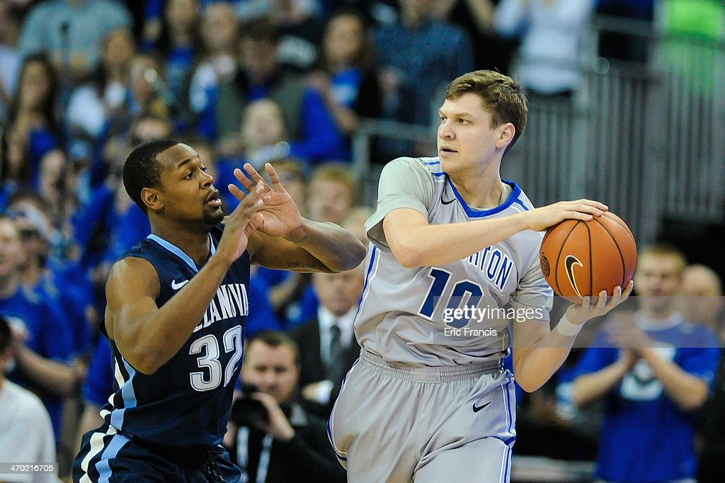 James Bell #32 of the Villanova Wildcats guards Grant Gibbs #10 of the Creighton Bluejays during their game at CenturyLink Center on February 16th, 2014 in Omaha, Nebraska.