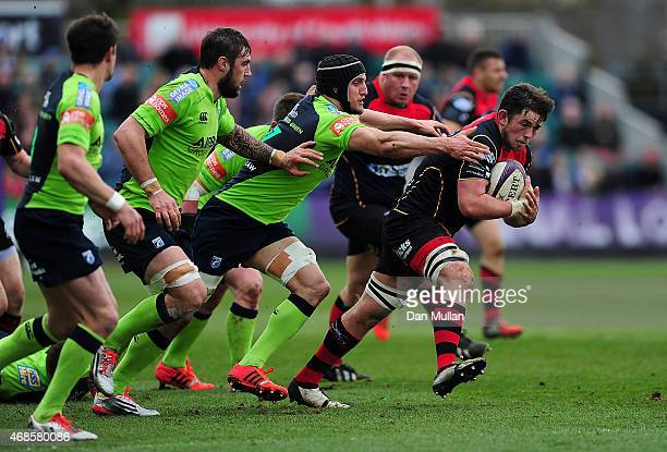 James Benjamin of Newports Gwent Dragons is tackled by Sam Warburton of Cardiff Blues during the European Rugby Challenge Cup match between Newport...