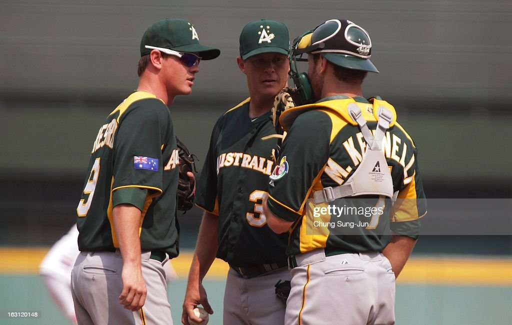 James Beresford, Chris Oxspring and Tim Kennelly of Australia confer during the World Baseball Classic First Round Group B match between Australia and the Netherlands at Intercontinental Baseball Stadium on March 5, 2013 in Taichung, Taiwan.
