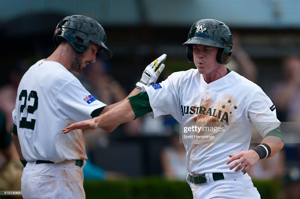 James Beresford of Australia celebrates after scoring a run during the World baseball Classic Final match between Australia and South Africa at Blacktown International Sportspark on February 14, 2016 in Sydney, Australia.